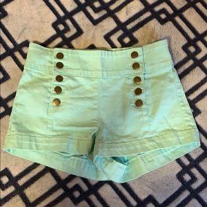 Light mint green/teal shorts